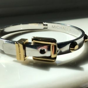 Michael Kors silver and gold buckle bracelet.